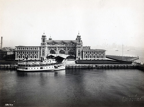 Boat Docked in Front of Ellis Island