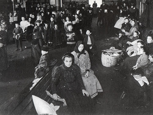 Detained Immigrants in a Waiting Room at Ellis Island