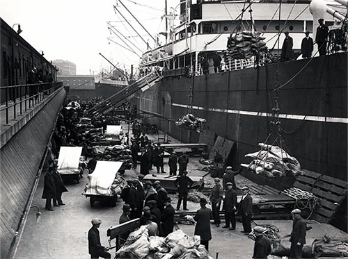 Loading Provisions, Supplies, and Cargo onto a Steamship ca 1915