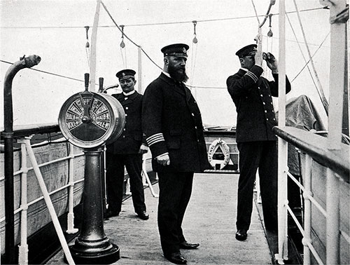 Officers on the Bridge. Captain and chief officer watching a passing ship.