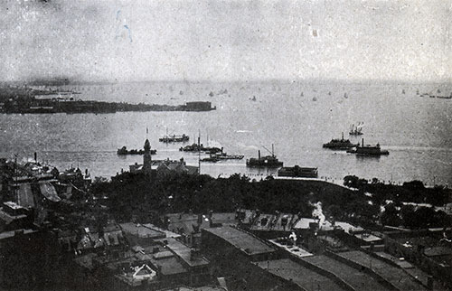 View of Busy New York Harbor with Many Steamships Visible in Foreground and Background.