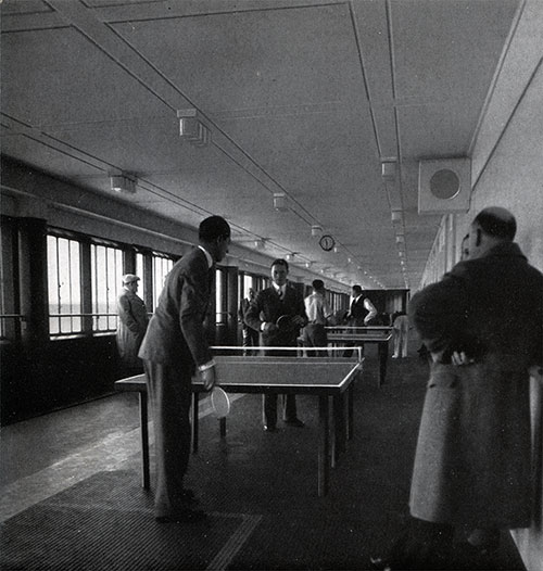 Passengers Play Table Tennis on the Promenade Deck.