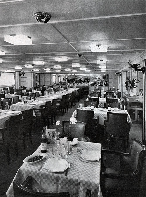 In the Delightful Dining Room, 65 Feet Long by 30 Feet, Decorated in Soft Green, Passengers Enjoy Delicious Cuisine.