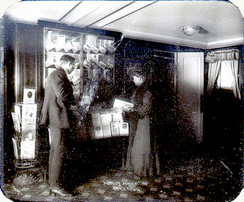 Passengers Browse the Brochure Kiosk on Board the SS Victoria. Glass Plate Image Circa 1900.