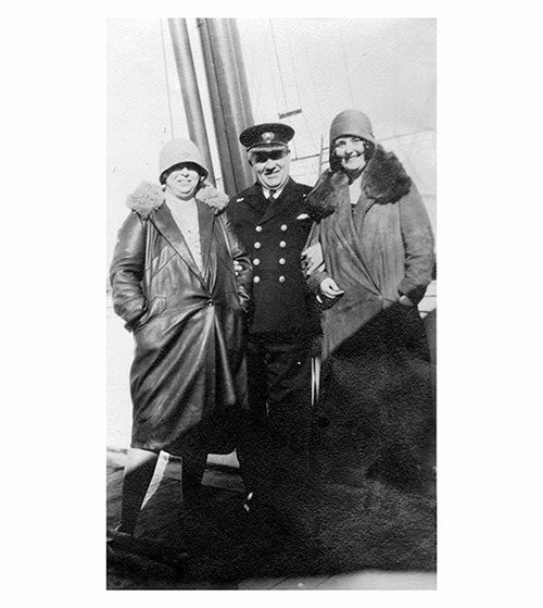Miss V. Mulholland and Friend Pose with the Chief Officer of the SS Lapland