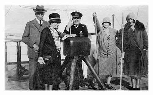 Miss Mulholland and Traveling Friends Pose with the Chief Officer of the SS Lapland During Voyage