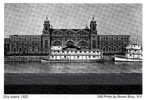 Ellis Island, 1922 with Two Barges Docked in Front of the Main Building.