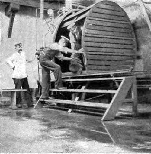 The Big Steam-Box in Which the Outer Clothing of the Immigrant Undergoes Disinfection.