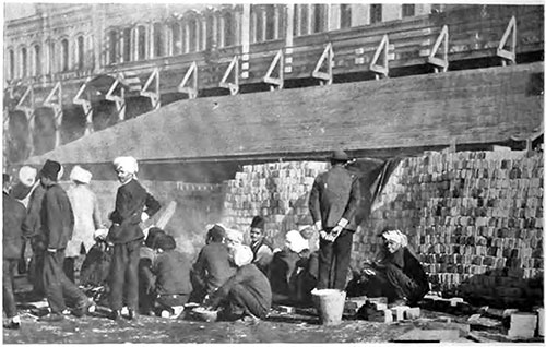 Hindu Immigrants Preparing a Meal on CPR Wharf at Victoria, BC.