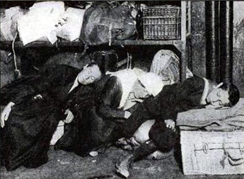 Overcrowding at Ellis Island Causes Unusual Sleeping Arrangements for Immigrants.