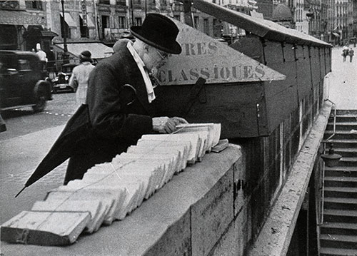 A Man Views Book for Sale in One of the Many Small Kiosks that Line the Seine in Paris.