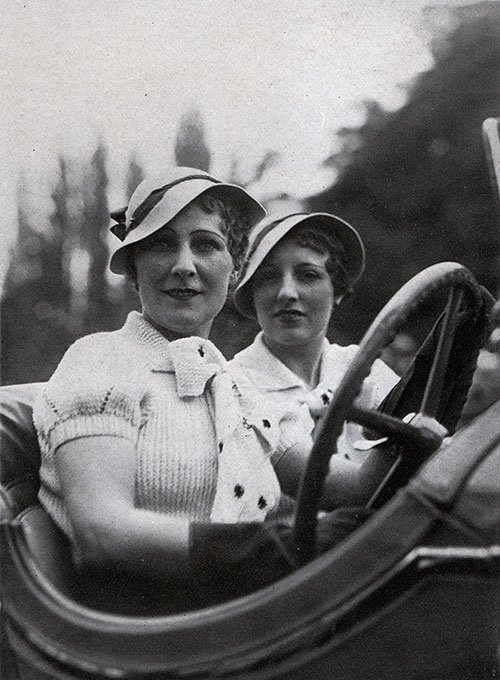 Two Women in Their Motorcar Display the Latest Fashions from Paris.