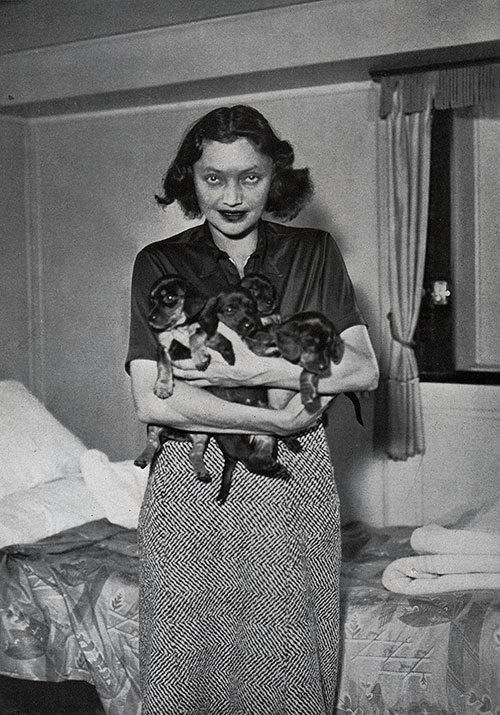 Katharine Cornell and Her Dogs in Her Stateroom on the SS Bremen.