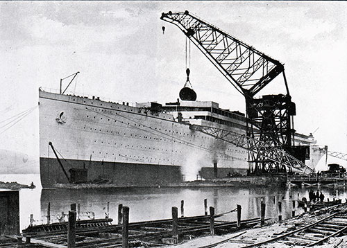Fig. 41: Floating Crane Lifting a Boiler on Board the Olympic - 9 November 1910.