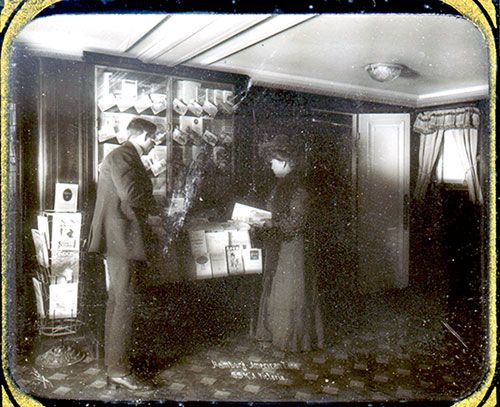 Steamship Passengers Browsing Through Brochures at a Kiosk in the Early 1900s.