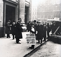 A Newspaper Boy in London Holds the Evening Newspaper Splashing the Headline of 'Titanic Disaster. Great Loss of Life.'