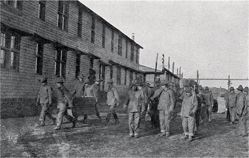 Men from the 302nd Field Artillery Shown Policing the Grounds of Camp Devens.