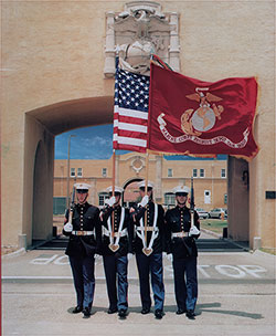 Four Marines in Parade Dress Carrying the US Flag and Flag of the USMC, Standing Outside San Diego MCRD.