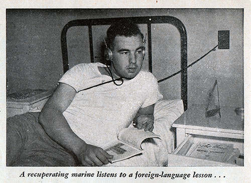 A recuperating marine listens to a foreign-language lesson