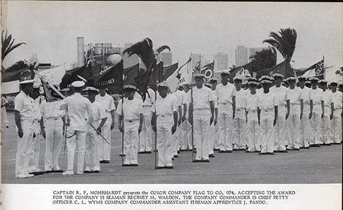 Captain R. F. Mohrhardt Presents the Color Company Flag to Co. 074.