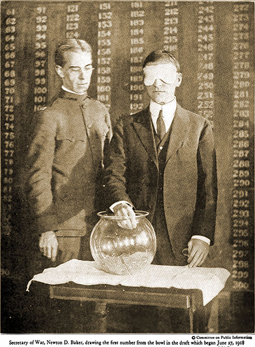 Secretary of War, Newton D. Baker, Drawing the First Number from the Bowl in the Draft Which Began June 27, 1918.