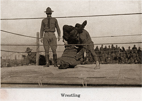 Wrestling While in Full Soldiers Uniform Must Be Difficult.