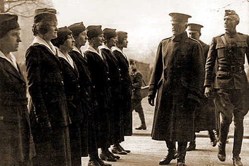 Gen. John Pershing, Commander of the American Expeditionary Forces in France during World War I, Reviews American Female Telephone Operators.