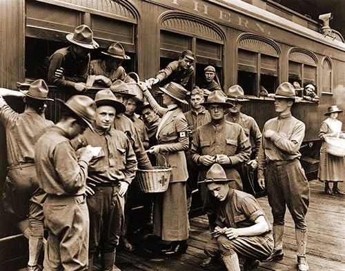 Canteen Workers from the American Red Cross Supply Soldiers with Snacks and Sundry Items at the Union Station, St. Paul, Minnesota, c1917.
